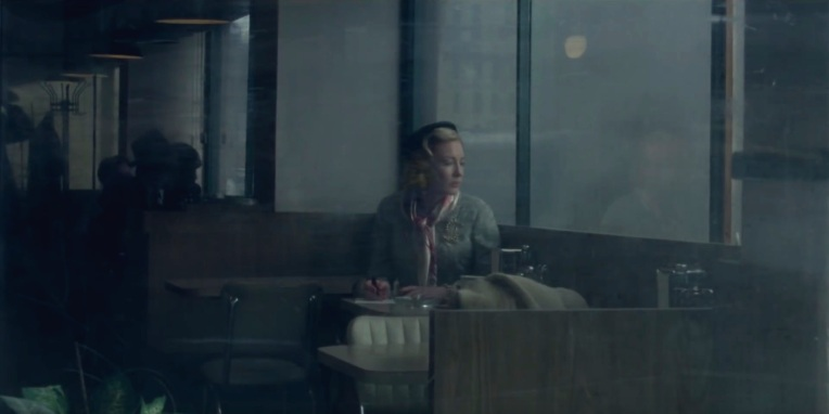 Carol behind glass